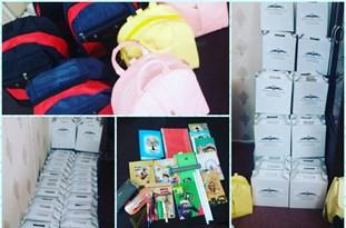 توزیع بستههای لوازمالتحریر بین دانشآموزان شعبه قم